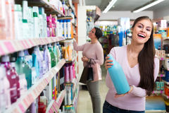 Women selecting hair care in store Royalty Free Stock Photos