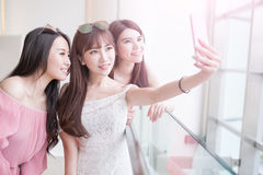 Women selfie in mall. Women selfie and smile happily in the shopping mall Royalty Free Stock Photo