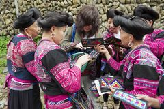 Women sell souvenirs to a tourist in Longji, China. Royalty Free Stock Images
