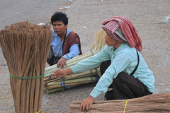 Women Selling Brooms Royalty Free Stock Photos