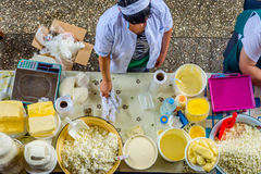 Women selling butter and cheese at the bazaar Stock Photos