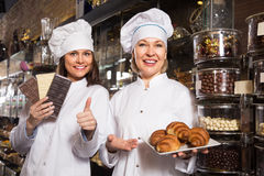 Women selling chocolates and sweet pastry Stock Image