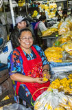Women selling fresh flowers at the morning market Pak Khlong Tha Stock Photos
