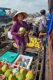 Women selling goods from a boat on the Mekong River, Vietnam Royalty Free Stock Photos