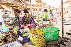 Women selling local goods  at asian marketplace. Bagan, Myanmar Stock Photos