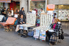 Women selling lottery tickets in Madrid Royalty Free Stock Image