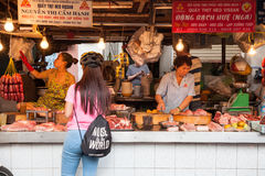 Women are selling meat at the wet market Stock Image