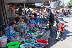 Women are selling seafood at the wet market. NHA TRANG, VIETNAM - DECEMBER 12: Women are selling seafood at the wet market on December 12, 2015 in Nha Trang Royalty Free Stock Photo