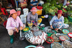 Women are selling seafood at the wet market Stock Photos