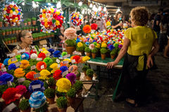 Women selling small vases with basil manjericos at the Alfama neighbourhood during the Saint Anthony Feast in Lisbon, Portugal. Lisbon, Portugal - June 12, 2014 Stock Image