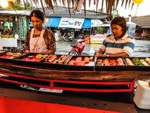 Women selling sushi Stock Photos