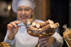 Women selling tarts and sweet pastry Royalty Free Stock Images