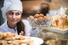 Women selling tarts and sweet pastry Stock Image