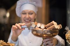 Women selling tarts and sweet pastry royalty free stock photo