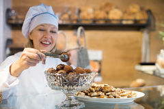 Women selling tarts and sweet pastry Stock Photos