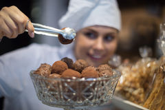 Women selling tarts and sweet pastry Royalty Free Stock Image