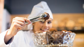 Women selling tarts and sweet pastry Royalty Free Stock Photos