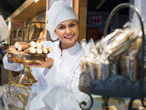 Women selling tarts and sweet pastry Stock Photography