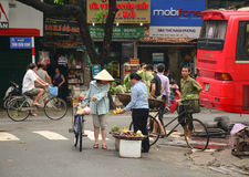 A women selling traditional fruits on a road Royalty Free Stock Images