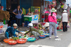 Women are selling vegetables at the wet market. NHA TRANG, VIETNAM - DECEMBER 12: Women are selling vegetables at the wet market on December 12, 2015 in Nha Stock Image