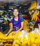 Women sells fresh flowers at Stock Photos