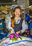 Women sells fresh orchids at the morning market Pak Khlong Thalat Stock Images