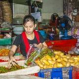 Women sells fresh potatoes at Royalty Free Stock Photography