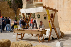 The women sells souvenirs at Mdina medieval festiva Stock Photos