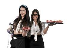 Women servers or waitresses. Women food service workers servers or waitresses Stock Photos