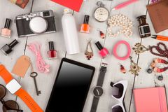 women set with accessories, tablet pc, smart watch, passport, camera, key, note pad, sunglasses, headphones, cosmetics makeup and stock photography