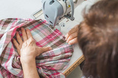 Women sew on sewing machine Stock Photo