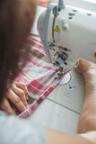 Women sew on sewing machine Royalty Free Stock Photo