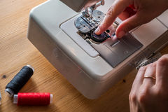 Women sewing with sewing machine Royalty Free Stock Images