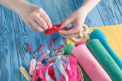 Women sews by hand and making handmade heart Royalty Free Stock Photos