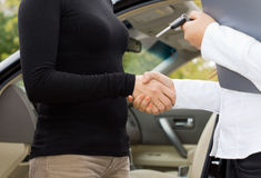 Women shaking hands on a car purchase Stock Photography