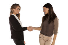 Women shaking hands Royalty Free Stock Photos