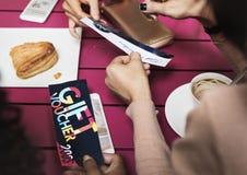 Women Share Gift Voucher Concept.  Stock Photo