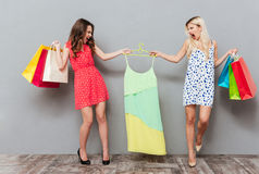 Women sharing dress Stock Photography