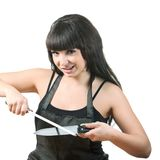 Women sharpen knife Stock Image