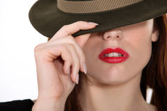 Women shielding face with hat Stock Photography