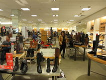 Women shoe store. Display of various type of shoes in a store inside an american mall Stock Images