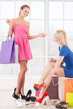 Women at shoe store. Stock Photos