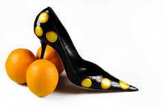 Women shoe with three oranges Royalty Free Stock Images