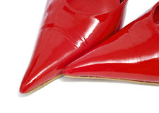 Women shoes. Closeup of a pair of women pointy red patent leather shoes royalty free stock photography