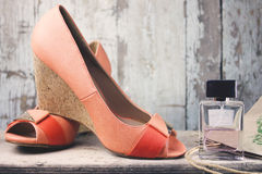 Women shoes. Women beautiful shoes and perfume Royalty Free Stock Images