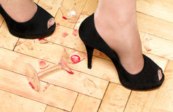 Women shoes and broken glass Royalty Free Stock Photos