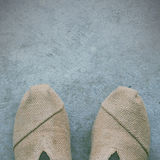 Women shoes on cement Royalty Free Stock Photography