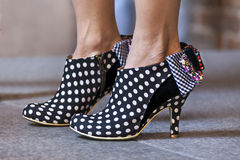 Women shoes in dots Stock Photos