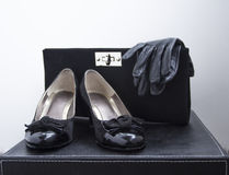 Women shoes gloves and purse Royalty Free Stock Photos