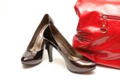 Women shoes and handbag. Women shoes  and red handbag over white Royalty Free Stock Photography